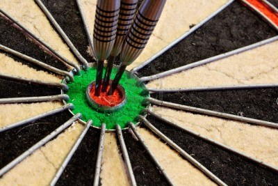 15486680-three-darts-in-the-bullseye-scoring-one-hundred-and-fifty-in-darts-tournament1